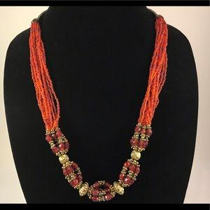 Red With gold tone beads gold tone info